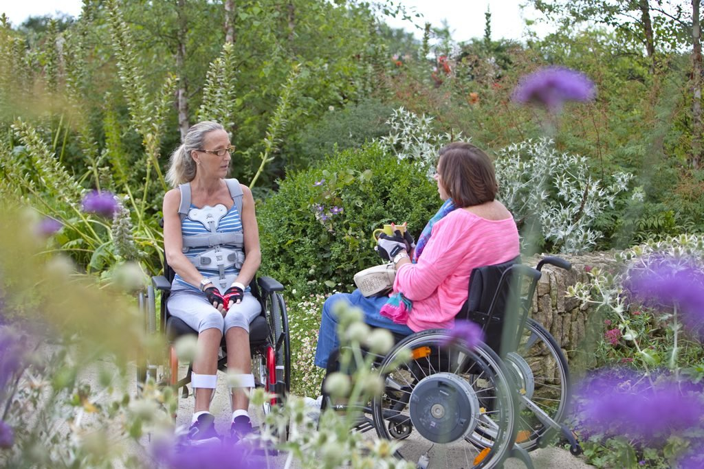 Spinal injuries patients in a garden