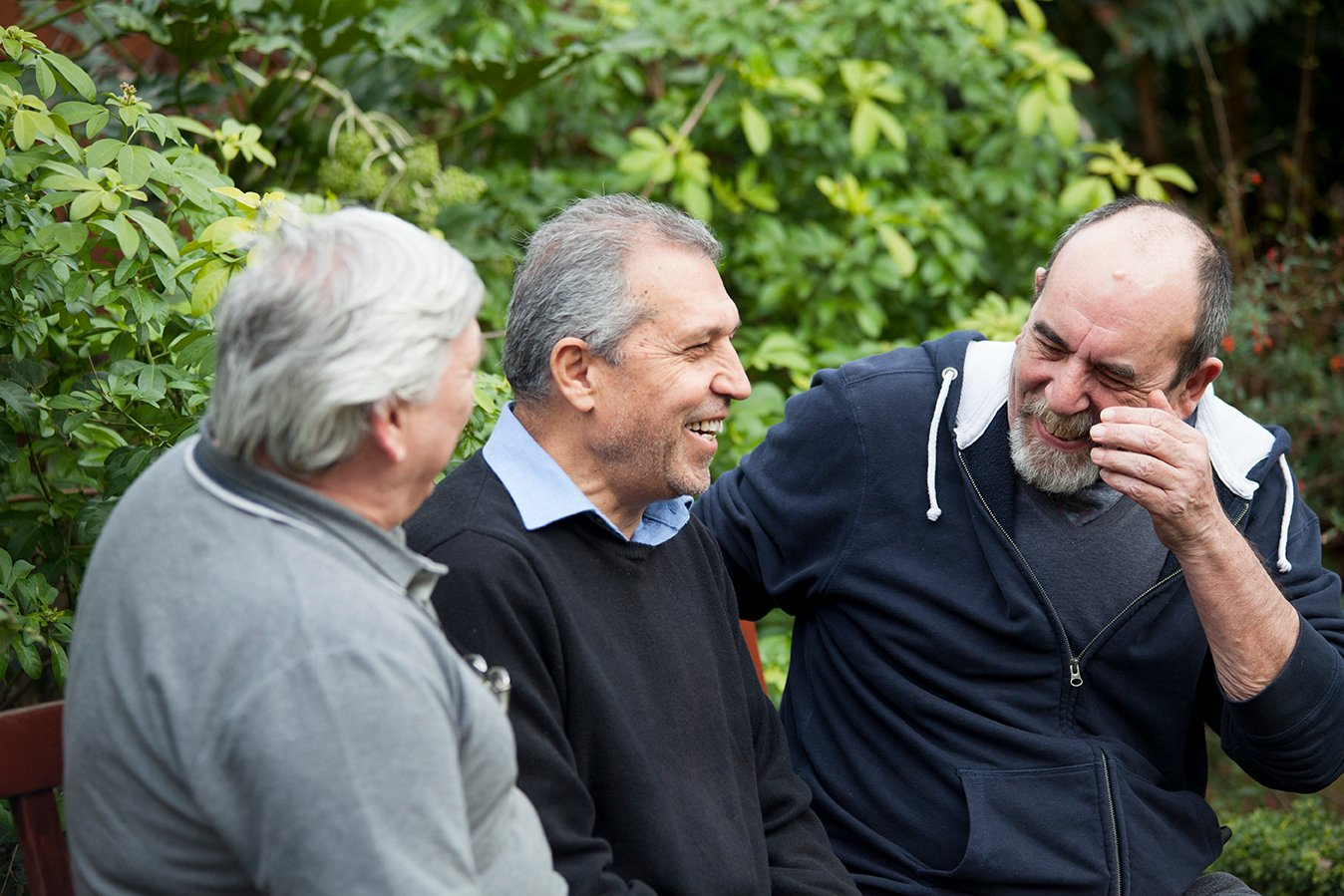 Male carers enjoying making new connections during their National Garden Scheme visit