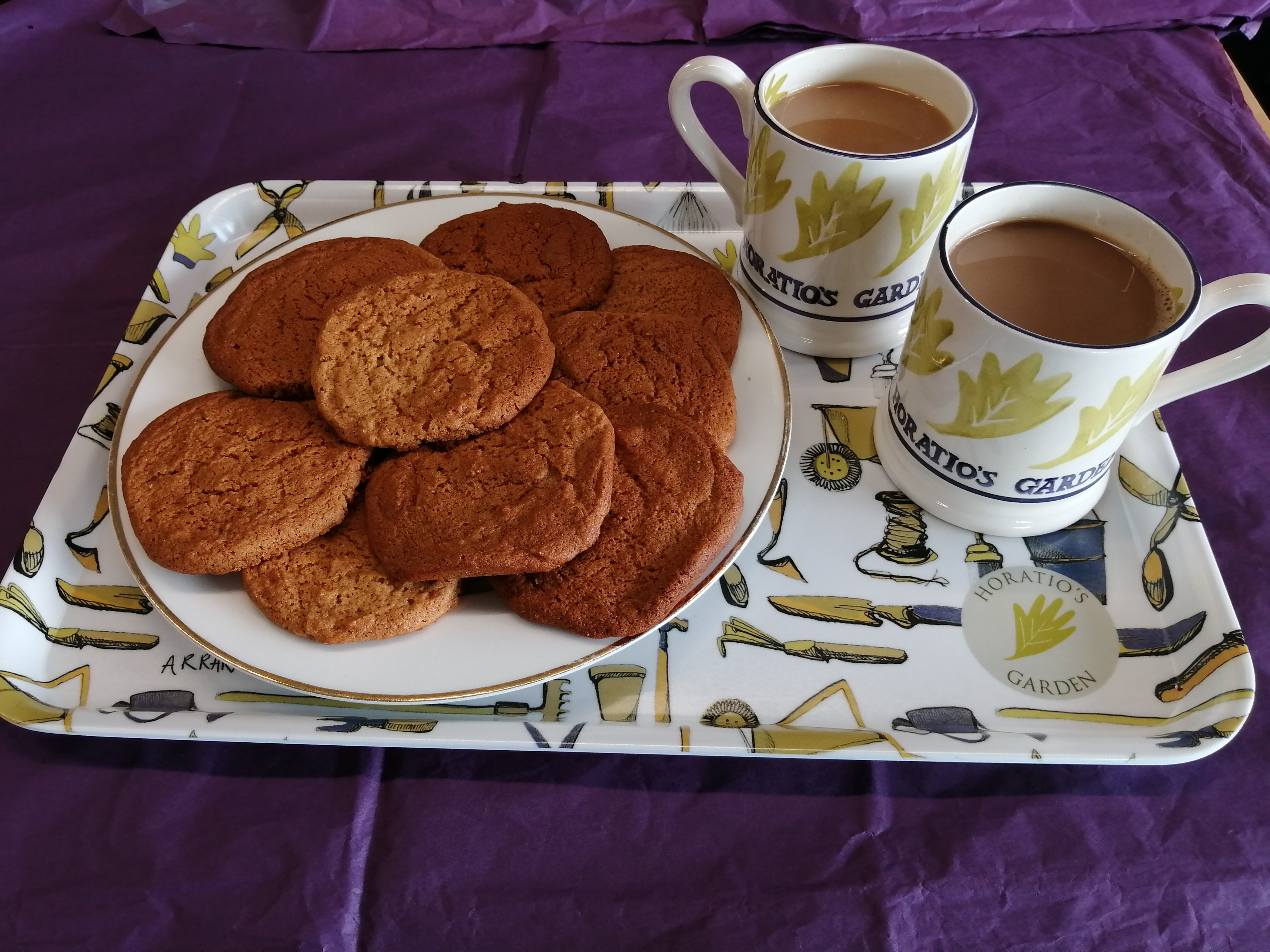 Ginger Biscuits on a tray with mugs of tea